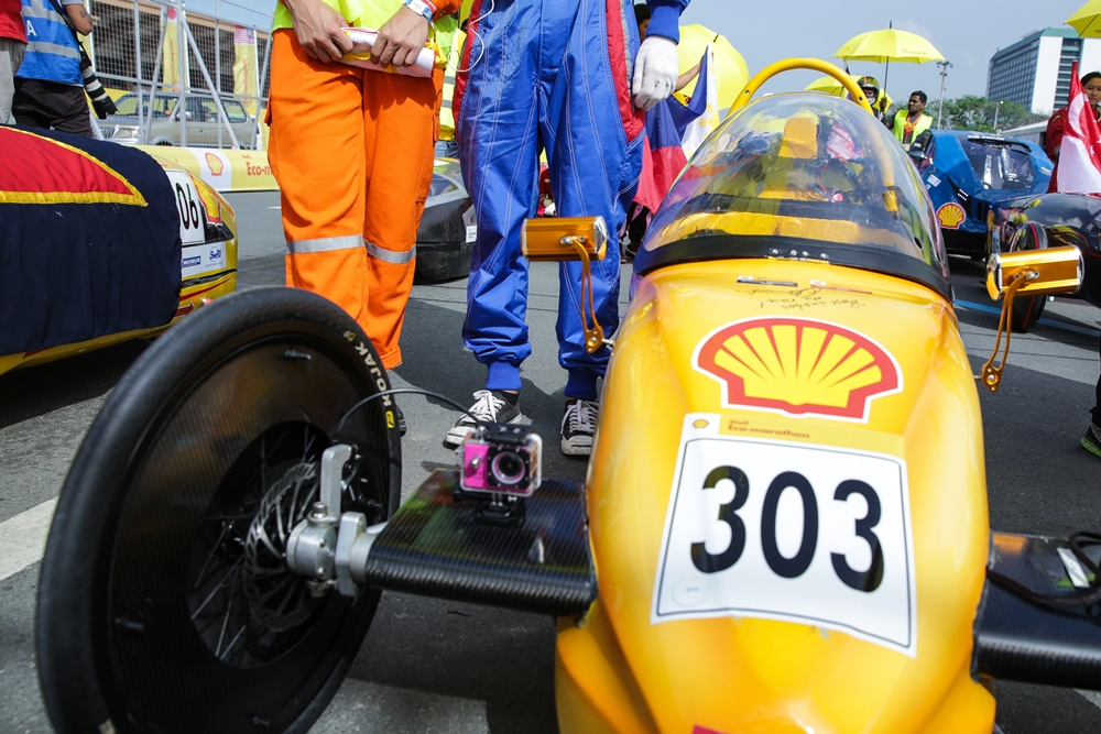 The EcoTraveller, #303, a battery electric prototype vehicle from team EcoTraveller at the Institute of Technical Education (ITE) in Singapore, is moved into position at the opening ceremony during day two of the Shell Eco-marathon Asia, in Manila, Philippines, Friday, March 4, 2016. (Kay Edwards/AP Images for Shell)